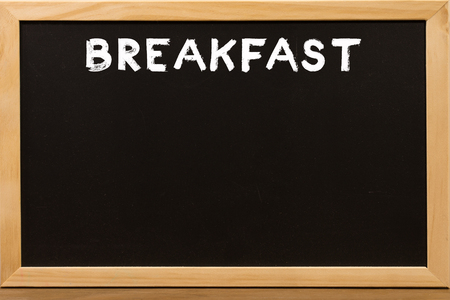 Breakfast write by white chalk on a blackboard. Stock Photo