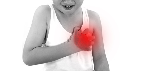 Boy is clutching her chest, acute pain possible heart attack. black and white photo