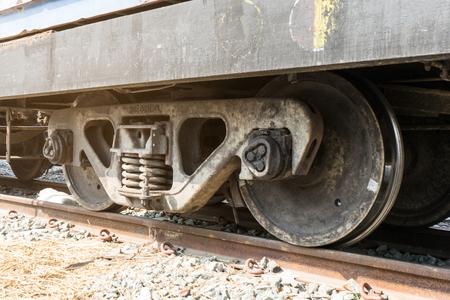 Train wheels on tracks with train bogie