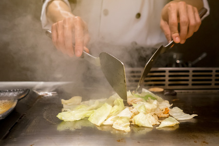 Abstract Chef is cooking Japanese style at the restaurant.