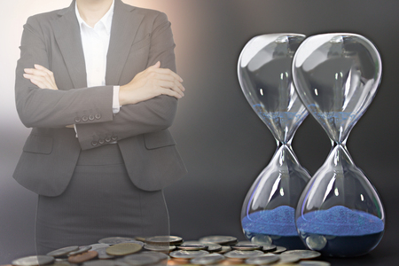 Business people with hourglass and coins in financial time on the investment concept.