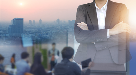 Double exposure of Business woman wearing suits on building and meeting hall background.