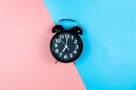 Alarm clock on color background.