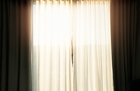 Curtain at the window in the morning. Reklamní fotografie