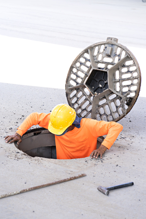 Worker in pipe at construction