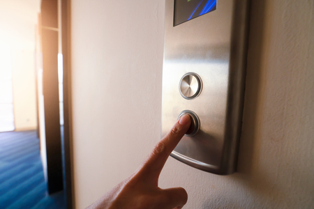 Finger push Pointing up the elevator.