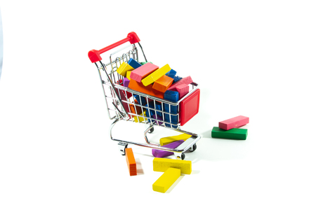 Toys in trolley on white background.  Concept shopping online for toys. Stock Photo - 124977382