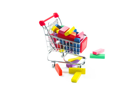 Toys in trolley on white background.  Concept shopping online for toys. Stock Photo - 124977383