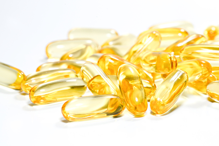 Fish oil capsule on isolated white background.