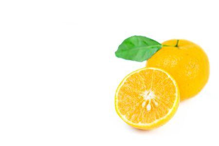 Orange fruits with leaf on isolated white background.