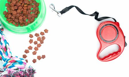 Dry food with pet accessories on isolated white background. Archivio Fotografico - 130791658
