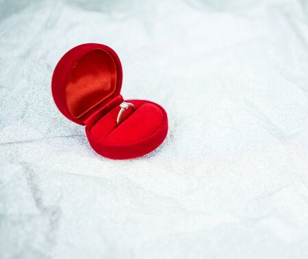 Red ring box with diamond ring for wedding day