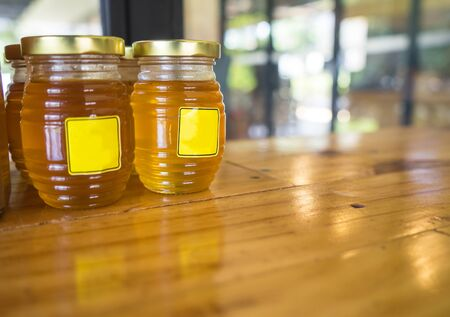 Honey in a glass jar on the table Фото со стока - 130790774