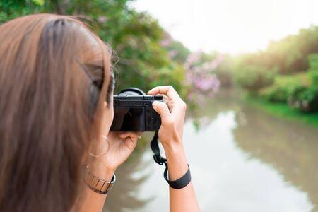 Woman take a photo at public park.  Travel concept