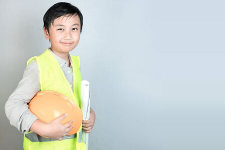 Little boy in engineering uniform with helmet and copy space