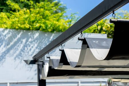 Retractable awning for outdoor interior design 스톡 콘텐츠