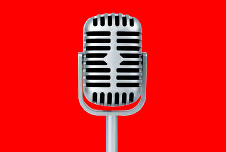 Retro microphone on red background 免版税图像