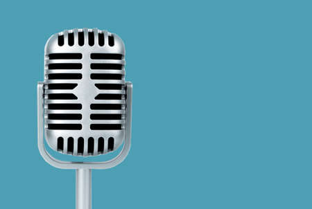 Retro microphone on blue background