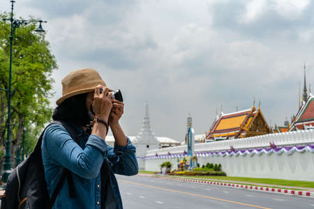 Tourists taking photo of famous temple at Thailand