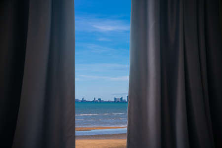 Curtain at the window in the morning. Sea view concept