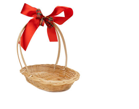 Empty gift basket with red-gold ribbon bow for Christmas and new year gift isolated on white 免版税图像