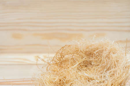 Haystack with copy space on wooden background