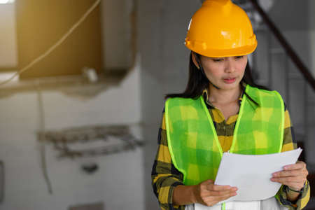 Women engineering with hard hat at construction site