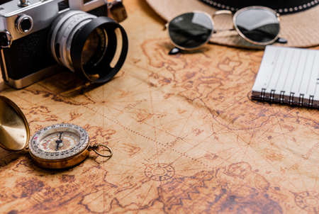 Vintage Compass and camera on map for travel planning 免版税图像