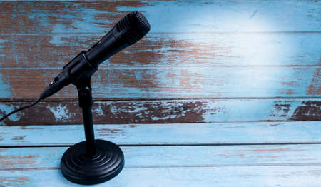 Microphone with stand on vintage background