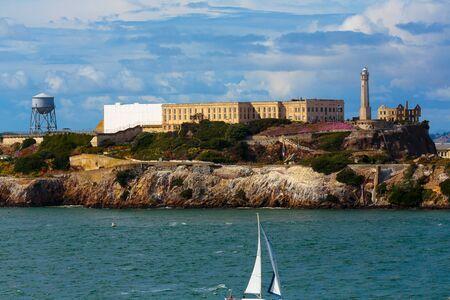 alcatraz: San Francisco, CA, USA - May 21, 2016: Sail boat cruisng past Alcatraz Island in the San Francisco Bay. Editorial