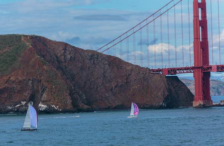 San Francisco, CA, USA - May 21, 2016:  Two sailboats cruising near the Golden Gate Bridge in San Francisco.