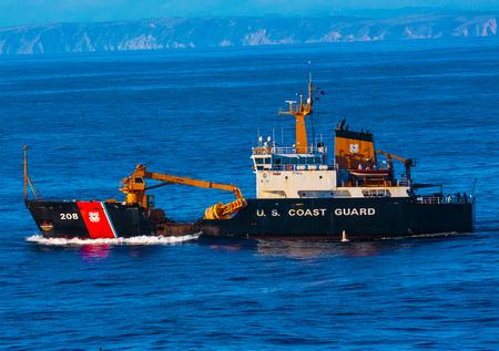 San Francisco, CA, USA - May 21, 2016:  Coast Guard Cutter Buoy Tender cruising in San Francisco Bay, just west of the Golden Gate Bridge. Editöryel