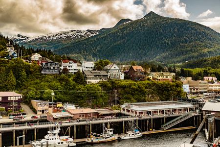 other keywords: Ketchikan, AK, USA - May 24, 2016:  View of homes, hills, clouds and docksde commercial properties in Ktchikan Alaska. Editorial