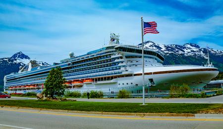 Skagway, AK, USA - May 26, 2016:  Cruise ship Grand Pricess at dock in Skagway, Alaska. Editöryel