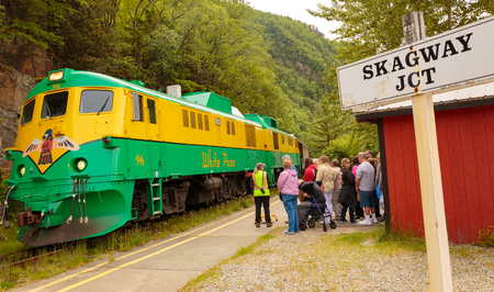 whitehorse: Skagway, AK, USA - May 26, 2016:  Passengers alight for a scenic train adventure to Whitehorse Pass. Editorial