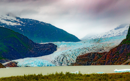 other keywords: Juneau, AK, USA - May 25, 2016:  View of the moraine and blue ice of the Mendenhall Glacier. Editorial