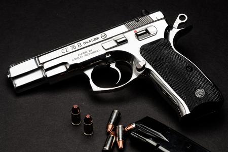 barrel pistol: Las Vegas, NV, USA - January 25, 2016:  Closeup of  CZ75 semiautomatic handgun with 9mm ammunition and magazine.