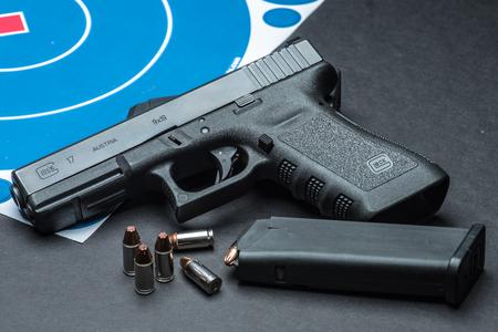 glock: Las Vegas, NV, USA - January 25, 2016:  Closeup of  Glock 17 semiautomatic handgun and 9mm amunition and magazine.