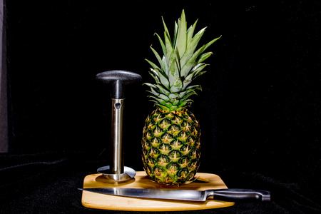 Las Vegas, NV, USA - February 19, 2016:  Convenient pineapple coring tool creates fresh pineapple rings easily and quickly.