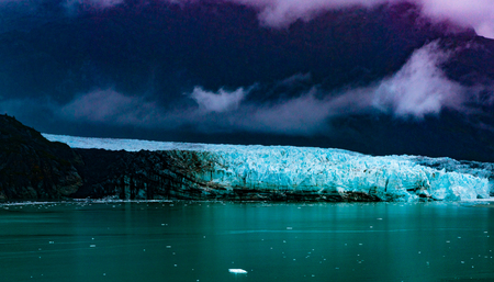 disenchantment: Hubbard Glacier, Alaska, USA - Sept. 11, 2016: This tidewater glacier is located in eastern Alaska and is part of Yukon Canada, off the coast of Yakutat—200 miles NW of Juneau Alaska. it is more than six miles wide where it meets the ocean. Stock Photo