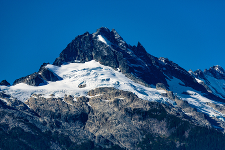 dione: Whistler, BC, Canada - Sept. 21, 2016:  The four major peaks of the Tantalus Range are named Alpha, Serratus, Dione and Tantalus (2603m). Stock Photo