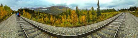Denali, Alaska, USA - Sept. 5, 2016:  Distorted perspective panorama of railroad tracks skirting through Denali National Park. Tracks are part of the Alaska Railrod system originating in Seward, terminating in Fairbanks.