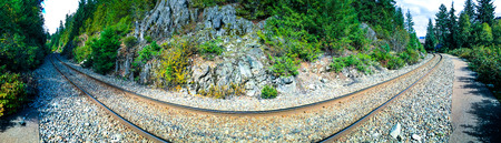 Whistler, BC, Cananda - Sept. 21, 2016:  Distorted perspective panorama of railroad tracks skirting through Whistler, near Alpha Lake. Tracks are part of the CN Railrod system. Stock Photo