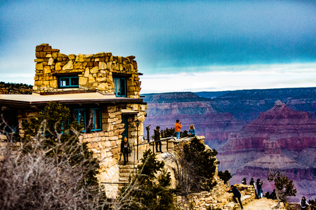 Grand Canyon NP, Arizona, USA - December 21, 2016:  Panorama of the Grand Canyon and the Lookout Studio as seen from the south rim, near the El Tovar Hotel in the Grand Canyon Village along the Rim Trail.