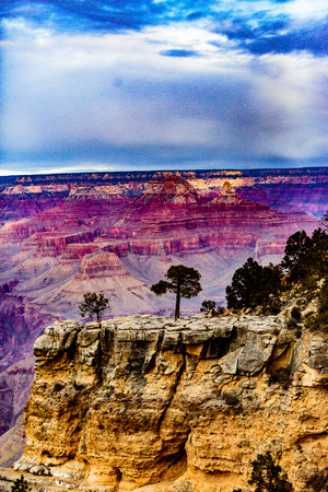 Grand Canyon NP, Arizona, USA - December 21, 2016:  Panorama of the Grand Canyon and Bright Angel Trail as seen from the south rim, near the El Tovar Hotel in the Grand Canyon Village along the Rim Trail.