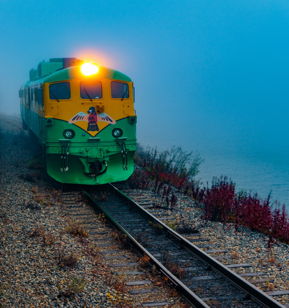 Skagway, Alaska, USA - September 13, 2016:  This historic railroad system makes daily scenic excursions over rugged terrain overlooking mountains, gorges, glaciers, waterfalls, forests, trestles and tunnels.