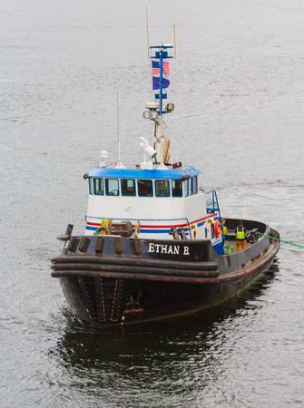 Ketchikan, Aaska, USA - September 15, 2016:  The 104 ton tug boat Ethan B servicing cruise ships as they dock in Ketchikan, Alaska.