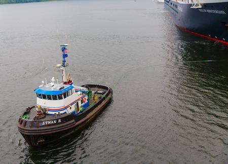 ethan: Ketchikan, Aaska, USA - September 15, 2016:  The 104 ton tug boat Ethan B servicing cruise ships as they dock in Ketchikan, Alaska.
