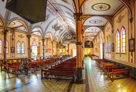 San Pablo, Costa Rica - April 3, 2017:  This beautiful church in a small village near San Pablo Costa Rica is a sense of pride in the community, along with the sculpted gardens of San Rafael de Heredia Park
