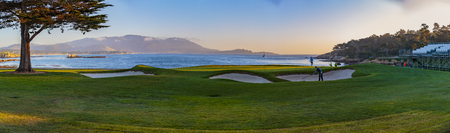 Pebble Beach, California: The famous 18th hole at the Pebble Beach golf links offers assorted seaview vistas in addition to challenging golf shots.